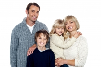 portrait-of-friendly-family-of-four-in-the-studio-100209431